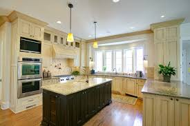 maple cabinets with black island antique white with glaze dark island custom wooden cabinets and