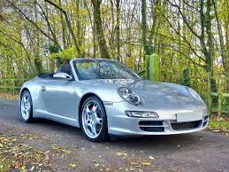 silver porsche carrera silver porsche 911 convertible free stock photo