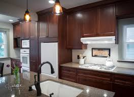 Dark Oak Cabinets With White Countertops And White Appliances