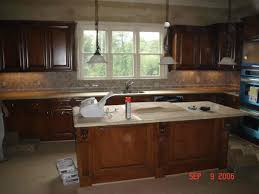 kitchen backsplash glass tile brown with cabinets stacked stone