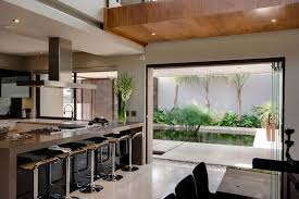 house sed architected nico van der meulen architects architecture small modern kitchen with marble table bar stools stove faucet exhaust indoor flower