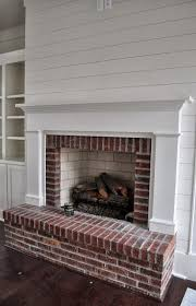 white shiplap walls with brick fireplace google search
