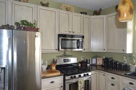 Painted Glazed Kitchen Cabinets Pictures by White Glazed Painted Cabinet Transformation For Less Than 100