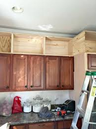 above kitchen cabinet storage ideas add crown molding to fill in those blank spaces above the cabinet