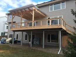 cedar deck louvered roof patio cover and custom storage cabinet