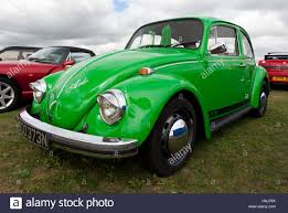 volkswagen beetle classic 2016 three quarter front view of a green 1974 volkswagen beetle on