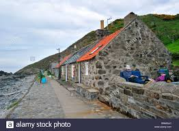 narrow picture ledge crovie a small village on a narrow ledge along the sea comprising a