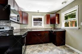 black kitchen cabinets with black appliances photos kitchen with bright burgundy cabinets and black appliances