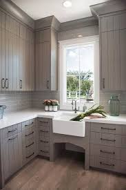 Laundry Room Cabinets With Sinks Gray Plank Laundry Room Cabinets With Farm Sink Transitional