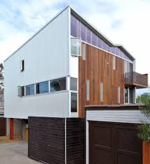 vertical wood siding exterior modern with wall lighting