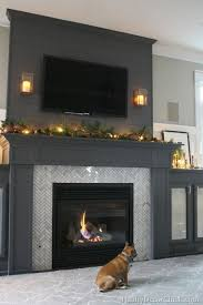 dark grey built in fireplace with side cabinets love the added height visual interest