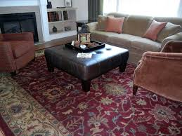 large square ottoman family room transitional with area rug audio