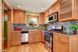 kitchen backsplash with light brown cabinets light brown kitchen cabinetry and brick tile back splash trim stock photo image now