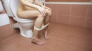 woman toilet pooping|