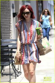 lily collins adds a u0027lily pad in bloom u0027 to her back tattoo photo