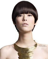 short boyish cut with a tapered neck for asian hair