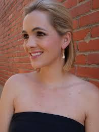 earrings on ear golden pearl drop earring gray pearl ex voto