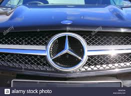 close up of the mercedes benz logo on the grill of a mercedes benz