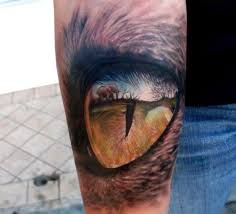 small elephant and eye on arm tattoomagz