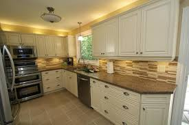 cream kitchen cabinets with stainless steel appliances design by