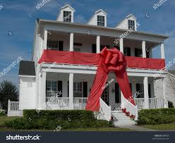 house giftwrapped giant red bow stock photo 884835 shutterstock