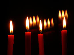 decorating wonderful fireplace candelabra with red candles for