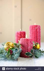cable knit christmas cable knit christmas candles and decorations stock photo 73956137