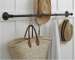 vintage iron pipe coat rack clothing display clothing store shelf wall