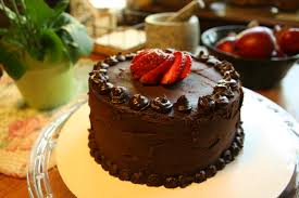 chocolate cake with chocolate frosting and strawberries wallpaper
