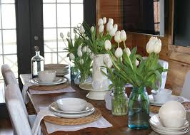 dining table center piece various shape of glass vase full white tulips for dining room table