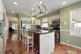 Green And White Kitchen Cabinets A Lovely Kitchen With Traditional White Cabinets A Terracotta