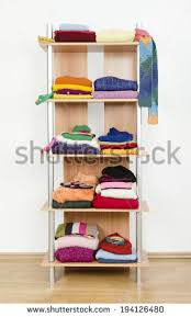 on the shelf accessories before untidy after tidy wardrobe colorful stock photo 194126468