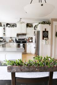 what to put on top of kitchen wall cabinets 18 ideas for decorating above kitchen cabinets design for