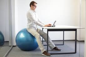 Exercise At Desk Job 4 Benefits Of Sitting On A Stability Ball At Work