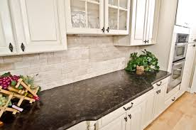 white kitchen cabinets with antique brown granite leathered antique brown granite and river valley granite in