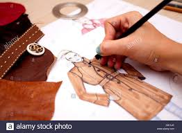fashion designer is drawing a fashion sketch for autumn winter