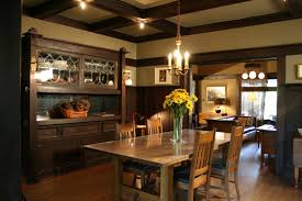craftsman style flooring exterior kitchen island with chandelier and wood chairs plus wood