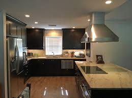 light granite countertops with dark cabinets proper lighting and light granite countertops offset dark cabinets