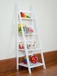 decorating ladder bookshelf in white on wooden floor matched with