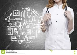woman doctor and blackboard with medicine sketches stock photo