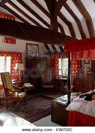 Red Curtains In Bedroom - bedroom with four poster bed with red velvet curtains and