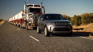 land rover discovery tows 110 ton road train with seven trailers