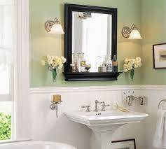 tranquil bathroom ideas white and green wall color with black wooden framed mirror for