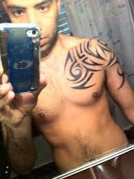 tribal on shoulder and chest