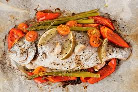 dorade cuisine dorade with vegetables roasted in culinary paper stock photo image