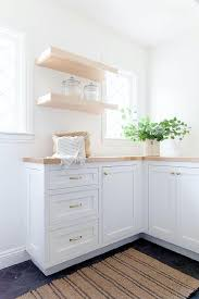 light grey kitchen cabinets with wood countertops light wood countertops on white laundry room cabinetry