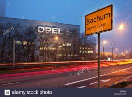 opel germany opel factory and place name sign on bochum in evening light