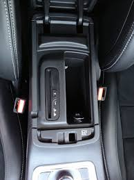 anyone remove cd player from under armrest on a 2014 cherokee