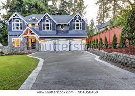 Curb Appeal Usa - luxurious home exterior blue vinyl siding stock photo 564058507