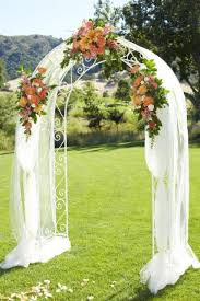 wedding arches using tulle green white flower wall by wed on beaufort available for hire